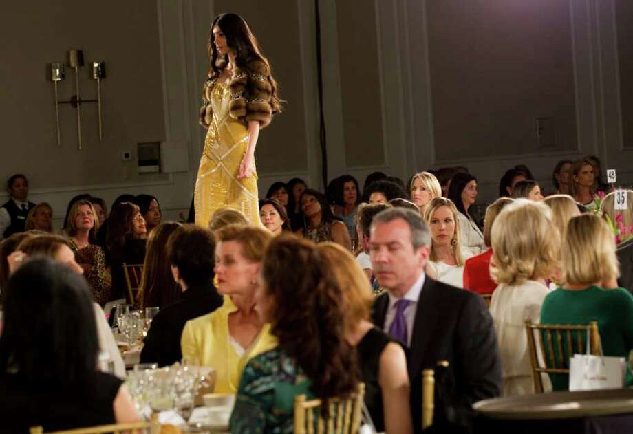 A model walks the runway during the annual Houston Chronicle Best Dressed Luncheon Wednesday, March 28, 2012, in Houston. Photo: Brett Coomer, Houston Chronicle / © 2012 Houston Chronicle