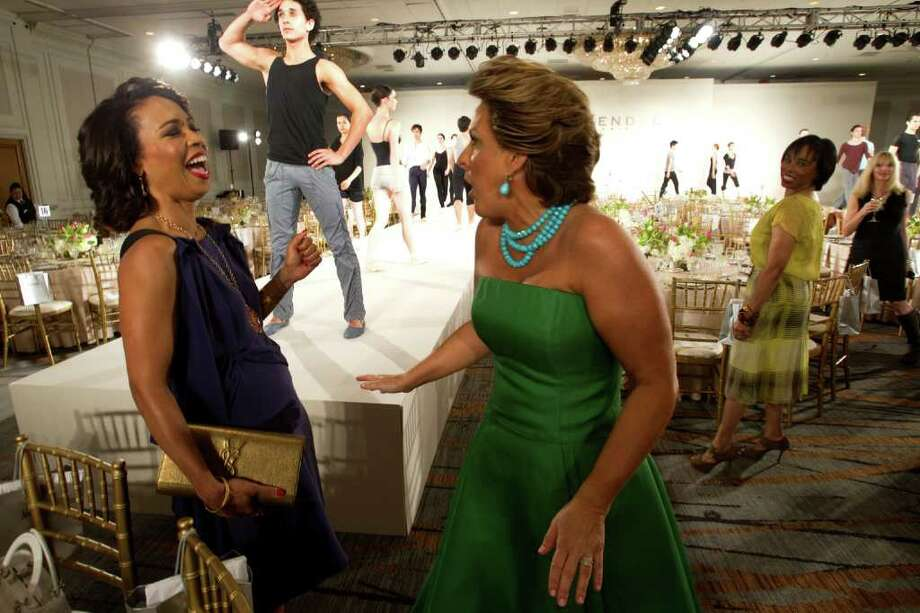 Gina Gaston Elie, left, shares a laugh with Mary Tere Perusquia before the annual Houston Chronicle Best Dressed Luncheon Wednesday, March 28, 2012, in Houston. Photo: Brett Coomer, Houston Chronicle / © 2012 Houston Chronicle