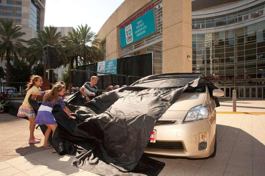 Toyota's 100 Cars for Good contest benefits nonprofit organizations. A Houston-area organization won a Prius last year. Photo: Toyota.com