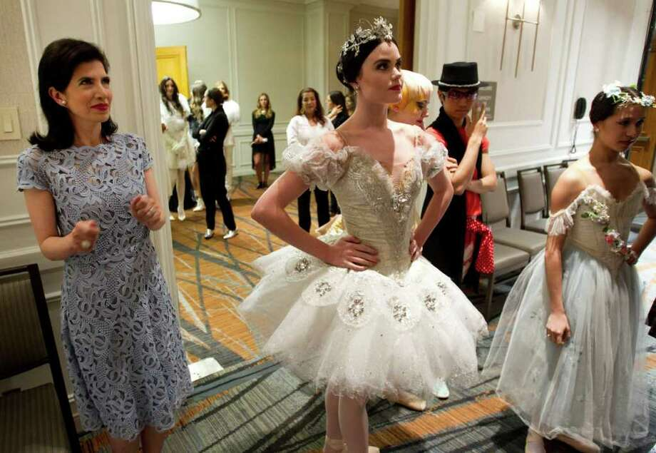 Dr. Kelli Cohen Fein, left, watches Houston Ballet dancers back stage during the annual Houston Chronicle Best Dressed Luncheon Wednesday, March 28, 2012, in Houston. Photo: Brett Coomer, Houston Chronicle / © 2012 Houston Chronicle