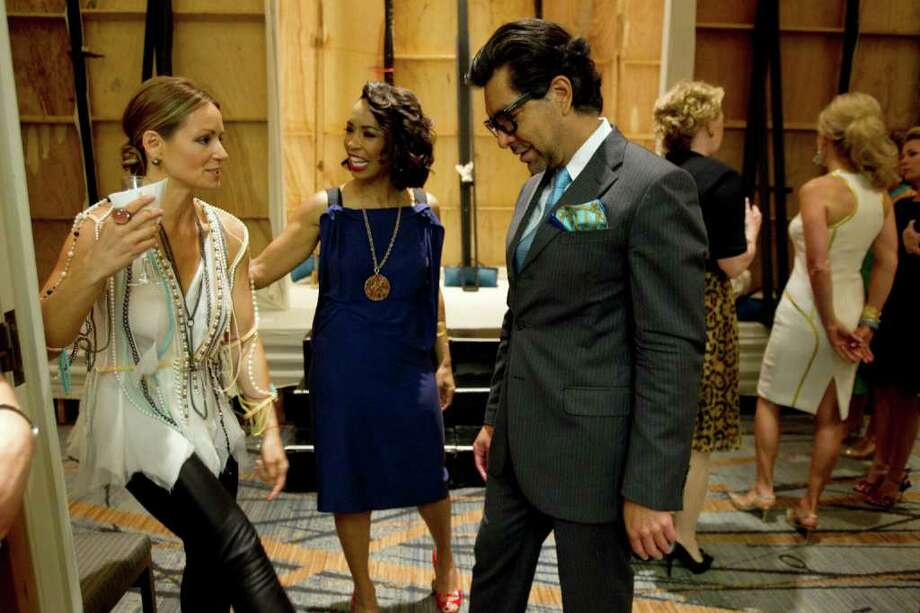 Lucinda Loya, left, and Gina Gaston Elie talk to Ceron during the annual Houston Chronicle Best Dressed Luncheon Wednesday, March 28, 2012, in Houston. Photo: Brett Coomer, Houston Chronicle / © 2012 Houston Chronicle