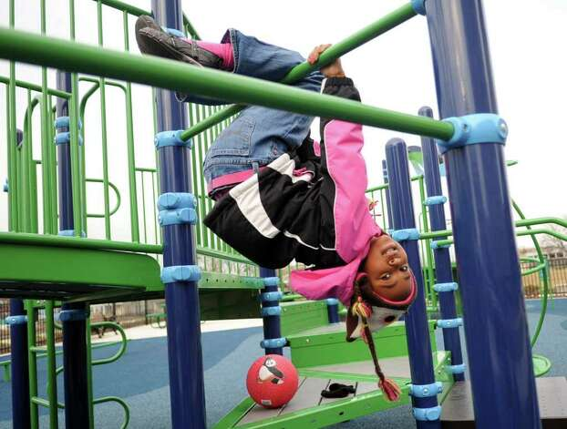 Aniya Bates, 6, plays at Commons Park in Harbor Point in Stamford on Saturday, February 18, 2012. Photo: Lindsay Niegelberg / Stamford Advocate