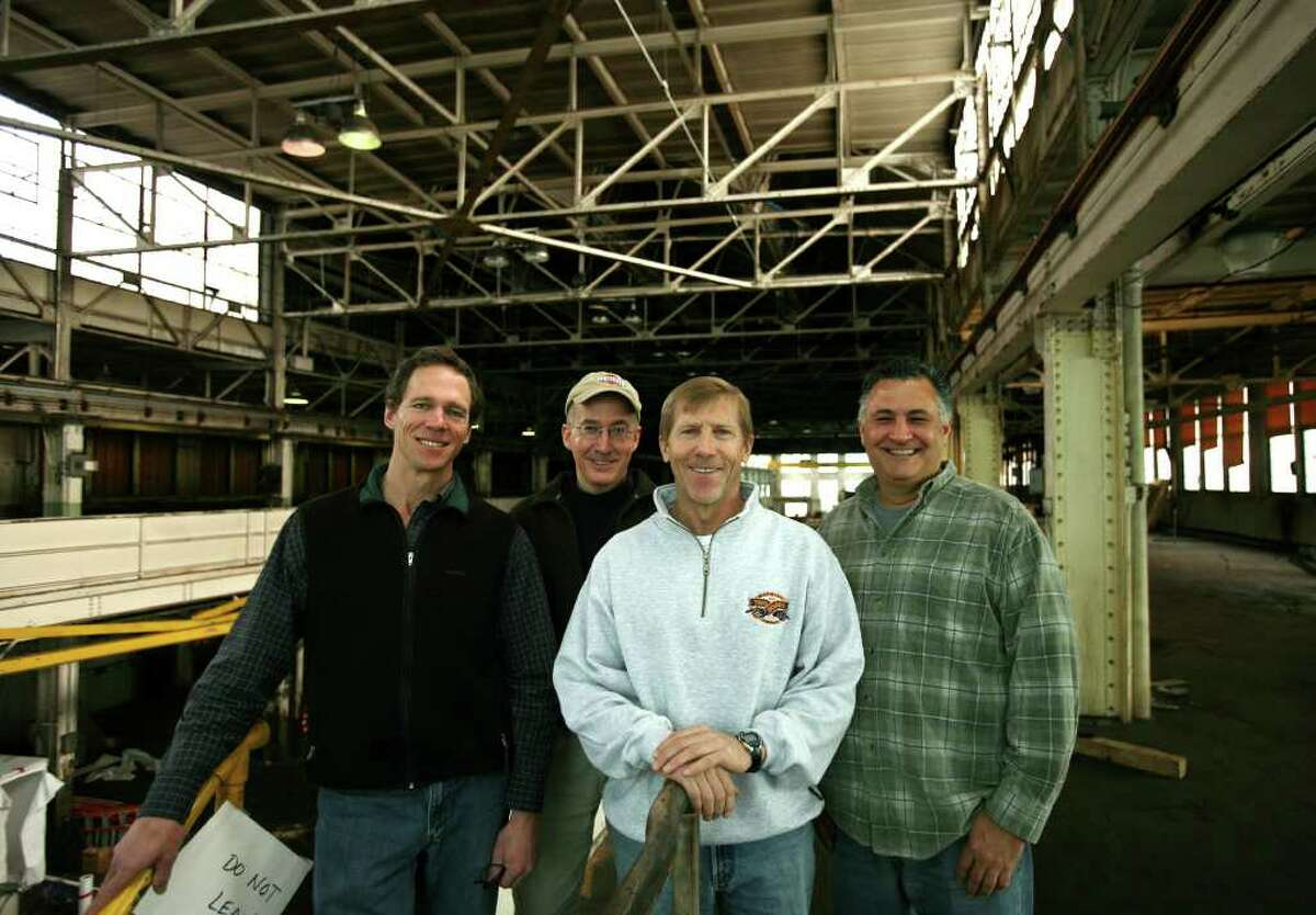 From left; Two Roads Brewing Company partners Peter Doering, Phil Markowski, Brad Hittle, and Clem Pellani received a $500,000 state grant for remediation of the former U.S. Baird factory at 1700 Stratford Avenue in Stratford. They plan to open their craft brewery, named Two Roads from the opening line in the Robert Frost poem The Road Not Taken, later this year.
