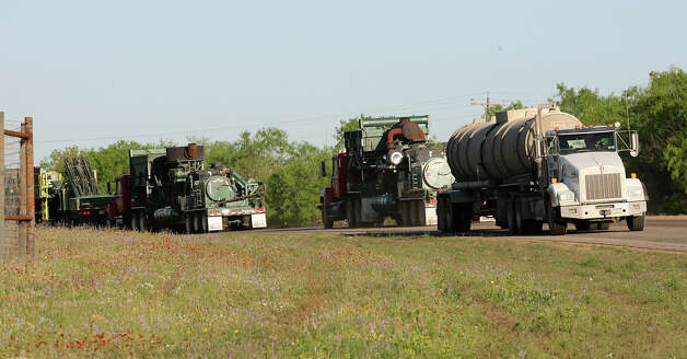 METRO -- Oilfield related traffic moves along FM 468 just northwest of Cotulla, Texas, Thursday, March 22, 2012. Traffic is up along most of the roads in the South Texas Eagle Ford Shale play. Jerry Lara/San Antonio Express-News Photo: JERRY LARA, San Antonio Express-News / SAN ANTONIO EXPRESS-NEWS