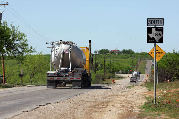 METRO -- Oilfield related traffic moves along FM 186 near Carrizo Springs, Texas, Wednesday, March 21, 2012. Traffic is up along most of the roads in the South Texas Eagle Ford Shale play. Jerry Lara/San Antonio Express-News Photo: JERRY LARA, San Antonio Express-News / SAN ANTONIO EXPRESS-NEWS