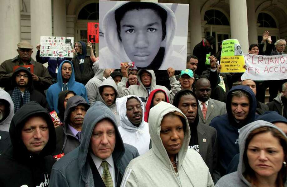 People along with New York City Council members attend a press conference to call for justice in the February 26 killing of 17-year-old Trayvon Martin in Sanford, Florida, on the steps of City Hall March 28, 2012, in New York City. Photo: Allison Joyce, Getty Images / 2012 Getty Images
