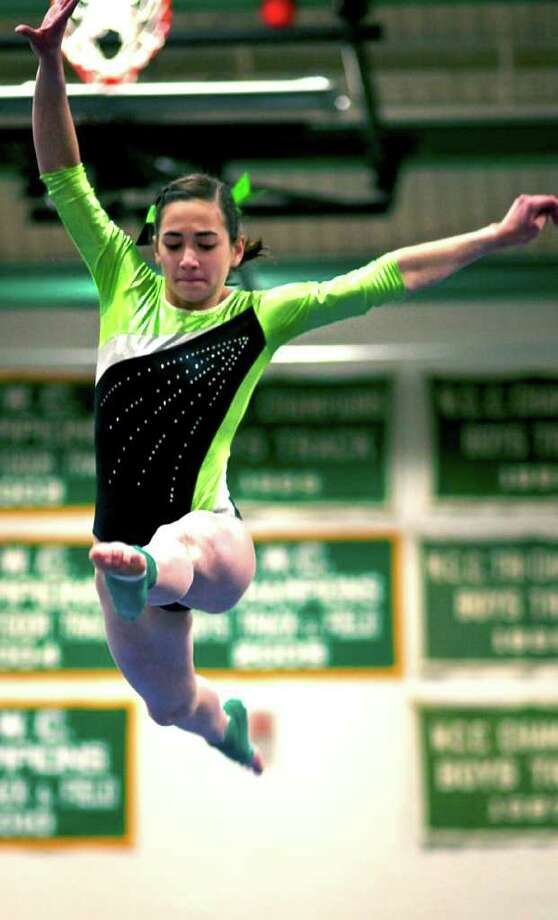 State class  SPECTRUM/Alison Profeta, a sophomore at New Milford High School, joined Green Wave senior teammate Carla Hernandez in state open competition Saturday with top gymnasts from throughout Connecticut, all within the friendly confines of the NMHS gym. For the story and more photos, see next Friday's Spectrum and check www.newmilfordspectrum.com. Photo: Trish Haldin