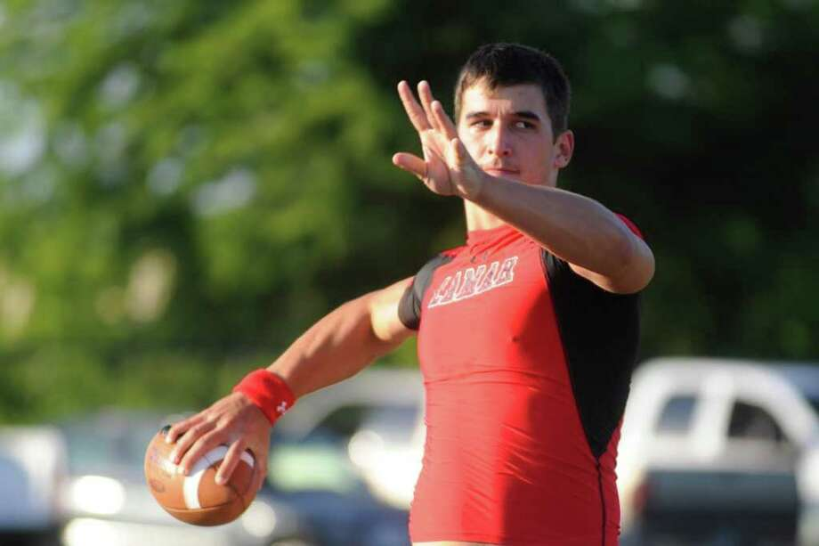 Lamar quarterback Harrison Tatum warms up before the start of the Cardinals scrimmage on Saturday at the Vernon Glass Field of Champions. August, 14, 2010 Valentino Mauricio/The Enterprise Photo: Valentino Mauricio / Beaumont
