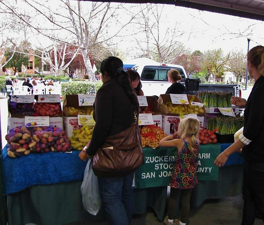 High-quality vendors mark the Davis market. Photo: Stephanie Wright Hession