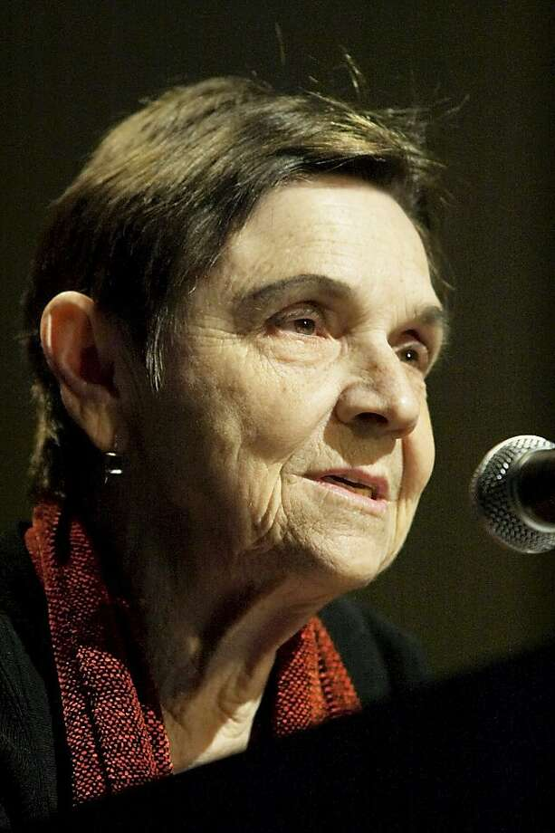 FILE - In this March 18, 2005 file photo, poet Adrienne Rich speaks at the 2004 National Book Critics Circle Awards after getting an award  in New York.Rich, whose socially conscious verse influenced a generation of feminist, gay rights and anti-war activists, has died. She was 82.  Rich, who had lived in Santa Cruz since the 1980s, died Tuesday, March 27, 2012 at her home. Her son, Pablo Conrad, says she died of complications from rheumatoid arthritis. (AP Photo/Adam Rountree, file) Photo: Adam Rountree, Associated Press