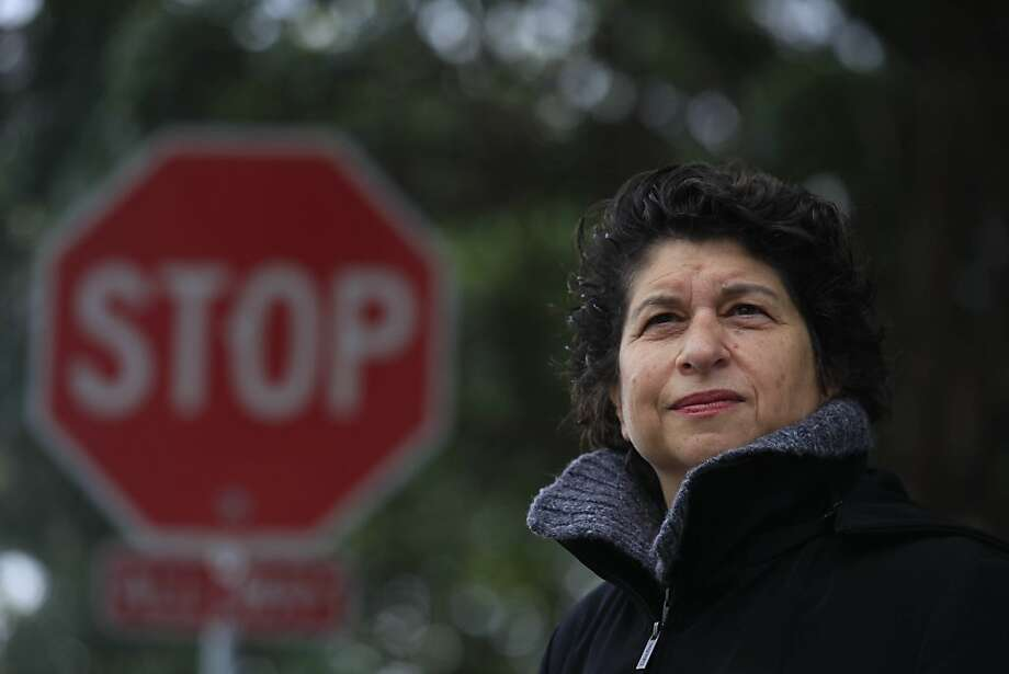 Pat Tura, chairman of Adopt a Corner program and Duboce Triangle Neighborhood Association board member, stands at the intersection at Duboce and Scott on Wednesday, March 28, 2012 in San Francisco, Calif. The groups first project was the STOP sign on Duboce Street at Scott which was hard to see due to the position of the sign and the trees surrounding it. Photo: Lea Suzuki, The Chronicle