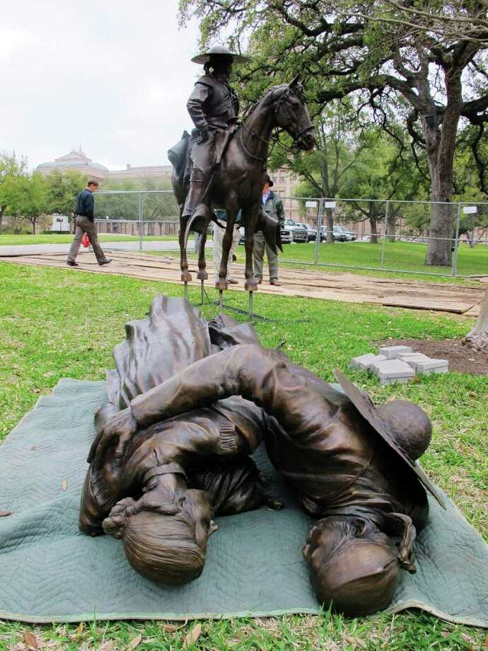 Parts of a monument to Tejanos wait to be erected early this month outside the state Capitol in Austin. Festivities tied to today's unveiling of the monument will include Saturday's re-enactment of the Tejano Declaration of Independence and the Nosotros los Tejanos Parade. Photo: Will Weissert, Associated Press