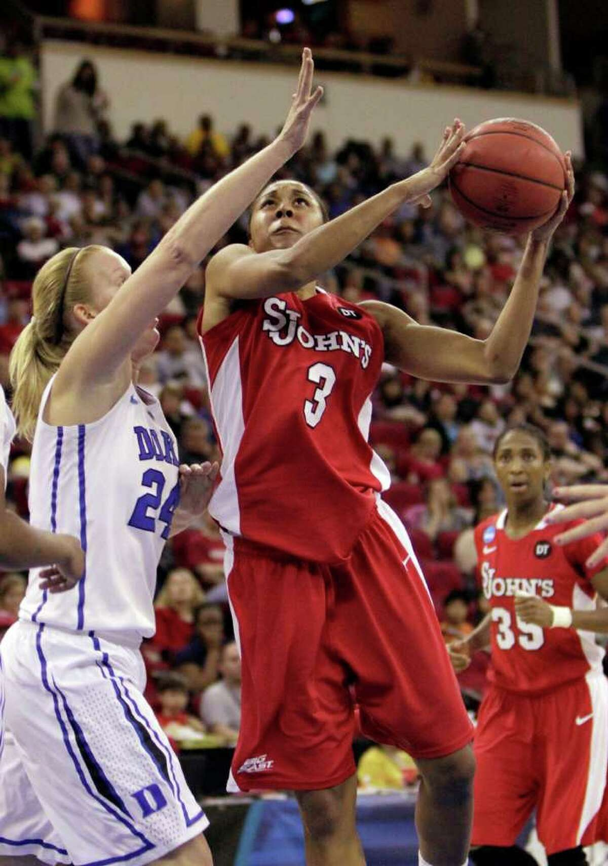 St. John's Da'Shena Stevens, right, drives to the basket against Duke's Kathleen Scheer during the second half of an NCAA women's tournament regional semifinal college basketball game, Saturday, March 24, 2012, in Fresno, Calif. Duke beat St. John's 74-47 and will play the winner of the game between South Carolina and Stanford.(AP Photo/Rich Pedroncelli)