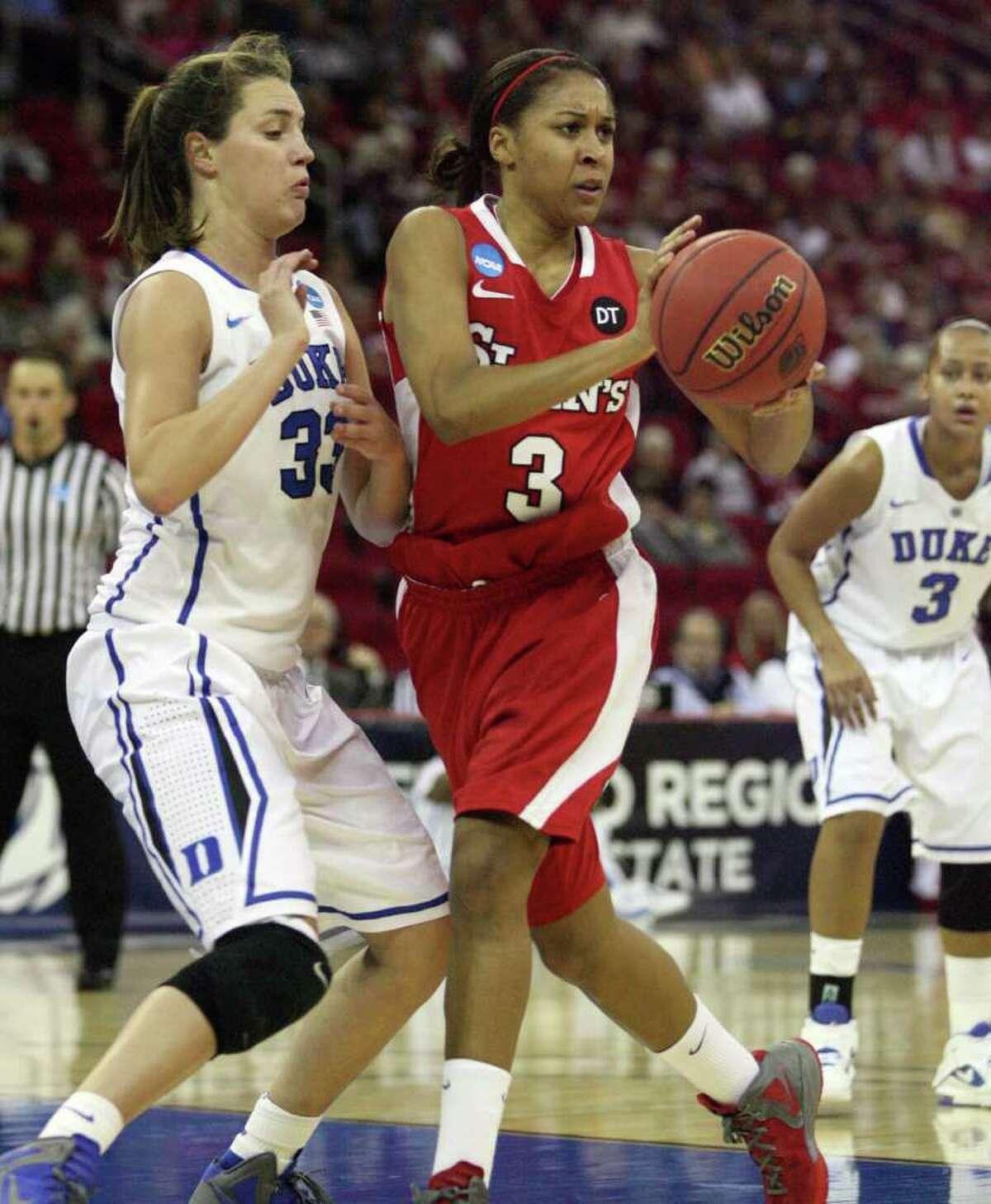 St. John's Da'Shena Stevens passes against Duke's Haley Peters during the first half of an NCAA women's tournament regional semifinal college basketball game Saturday, March 24, Fresno, Calif. (AP Photo/Gary Kazanjian)
