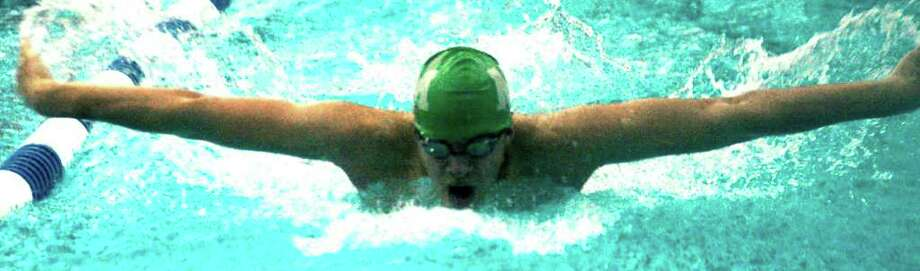 SPECTRUM/Scott Martin churns out the 100-yard butterfly for New Milford High School boys' swim, Feb. 16, 2012 at Canterbury School Photo: Norm Cummings