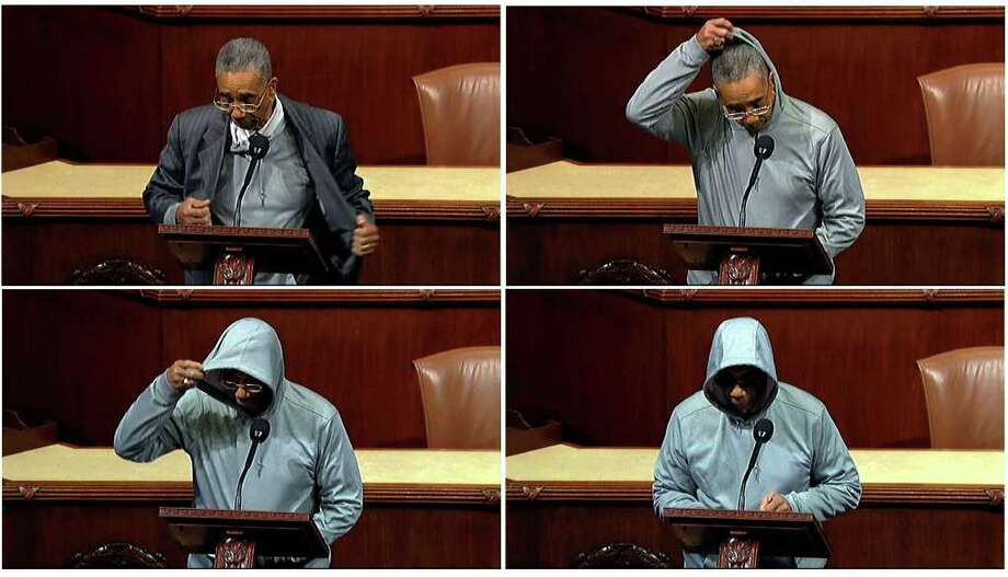 A series of frame grabs from video, provided by House Television, shows Rep. Bobby Rush, D-Ill., taking off his jacket to wear a hoodie and sunglasses as he speaks on the floor of the House on Capitol Hill in Washington on Wednesday. Rush was deploring the killing last month of Florida teenager Trayvon Martin. / House Television