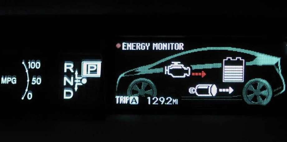 Energy monitoring display inside Tamara and Martin Goodman's  2010 Toyota Prius at their Niskayuna home Tuesday Feb. 28, 2012.  (John Carl D'Annibale / Times Union) Photo: John Carl D'Annibale / 00016572A