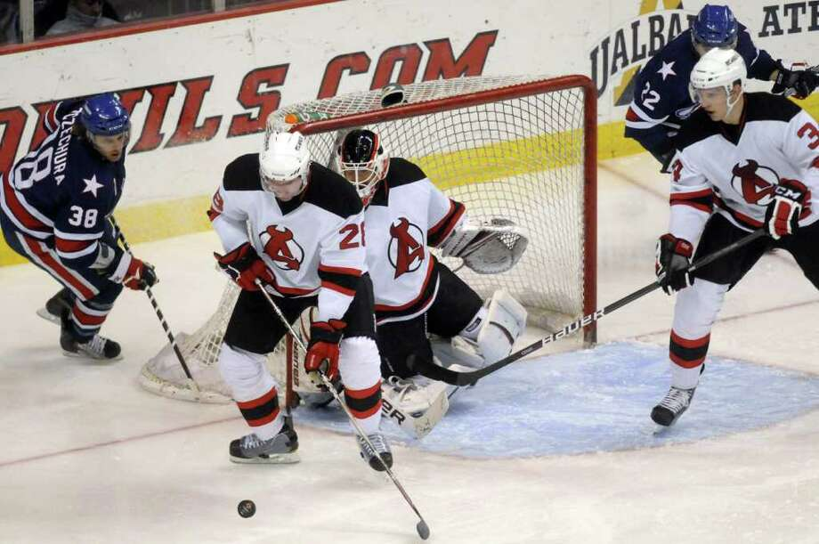 Albany Devils Dan Kelly clears a puck from the crease during their game against Rochester at the Times Union Center in Albany N.Y., Wednesday March 28, 2012. (Michael P. Farrell/Times Union) Photo: Michael P. Farrell