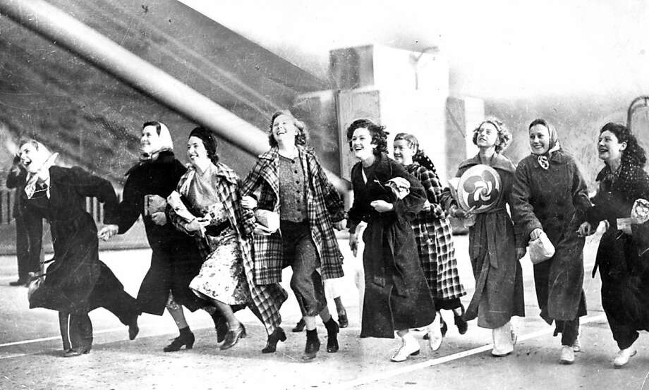 Nine laughing San Rafael High students run through the early morning fog as the Golden Gate Bridge opens. May 27, 1937. Photo: Chronicle Archives
