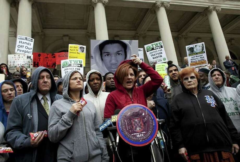 NEW YORK, NY - MARCH 28:  New York City Council Speaker Christine Quinn (C) puts on a hoodie as she speaks during a press conference to call for justice in the February 26 killing of 17-year-old Trayvon Martin in Sanford, Florida, on the steps of City Hall March 28, 2012 in New York City. Martin was killed by George Michael Zimmerman while on neighborhood watch patrol in the gated community of The Retreat at Twin Lakes.  (Photo by Allison Joyce/Getty Images)  *** BESTPIX *** Photo: Allison Joyce / 2012 Getty Images