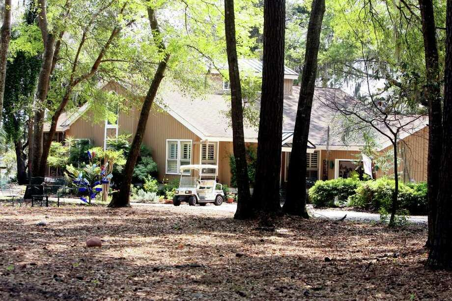 A home owned by JetBlue captain Clayton Osbon is seen in Richmond Hill, Ga. on Wednesday, March 28, 2012. Passengers aboard an early morning flight from New York bound for Las Vegas first noticed something wrong when Osbon came out of the cockpit, didn't close the door and tried to force his way into an occupied bathroom. (AP Photo/Lewis Levine) Photo: Lewis Levine
