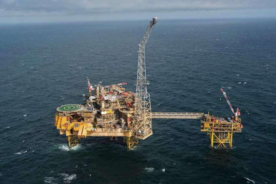 Total's Elgin platform, left, and wellhead platform off Aberdeen in eastern Scotland were evacuated this week after gas began leaking. Photo: - / AFP
