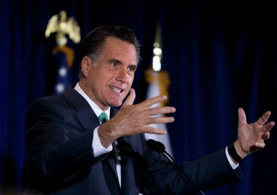 In this March 26, 2012, photo, Republican presidential candidate, former Massachusetts Gov. Mitt Romney gestures while speaking at NuVasive, Inc., a medical device company, in San Diego, Calif. Romney edged into the mop-up phase of the race for the Republican presidential nomination on Wednesday, March 28, 2012, buoyed by Newt Gingrich's decision to scale back his campaign to the vanishing point and Rick Santorum's statement that he would take the No. 2 spot on the party ticket in the fall. (AP Photo/Steven Senne) Photo: Steven Senne