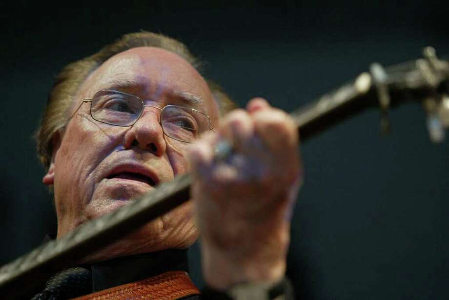 FILE - In this June 10, 2005 file photo, Earl Scruggs, performs at the Bonnaroo Music & Arts Festival in Manchester, Tenn. Scruggs' son Gary said his father passed away Wednesday morning, March 28, 2012 at a Nashville, Tenn., hospital of natural causes. He was 88. (AP Photo/Eric Parsons, File) Photo: Eric Parsons