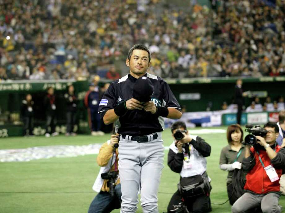 Seattle Mariners outfielders Ichiro Suzuki greets spectators during the opening ceremony of an  exhibition baseball game against Japan's Hanshin Tigers at the Tokyo Dome in Tokyo Sunday, March 25, 2012. The Mariners will meet the Oakland  Athletics in their two season-opening baseball games of the major league in Japan, at the Tokyo Dome from Wednesday.  (AP Photo/Koji Sasahara) Photo: Koji Sasahara / AP