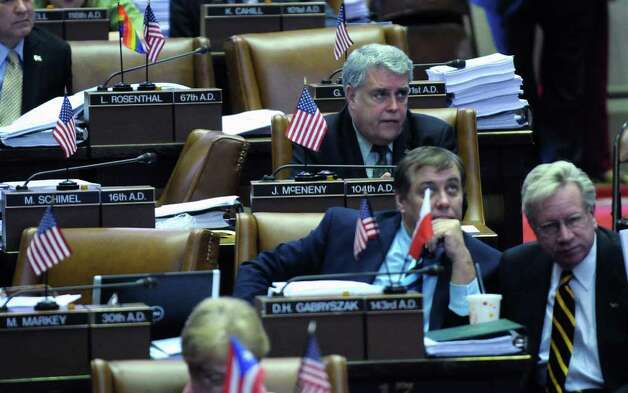 "Assemblyman John ""Jack"" McEneny at his desk in the Assembly chamber during budget voting in the Capitol on Wednesday March 28, 2012 in Albany, NY. (Philip Kamrass / Times Union ) Photo: Philip Kamrass / 00017021A"