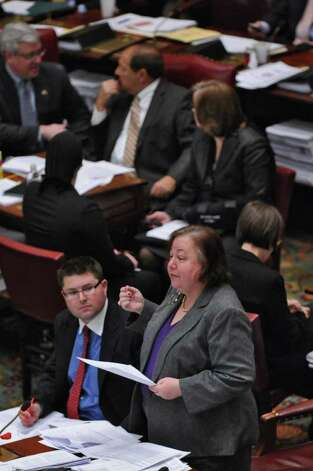State Senator Liz Krueger, foreground, speaks on the floor of the Senate chamber during budget voting in the Capitol on Wednesday March 28, 2012 in Albany, NY. (Philip Kamrass / Times Union ) Photo: Philip Kamrass / 00017021A