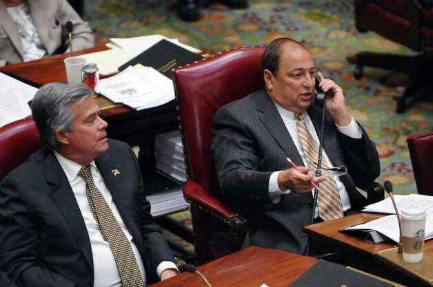 State Majority Leader Dean Skelos, left, and Deputy Majority Leader Tom Libous, right,  on the floor of the Senate chamber during budget voting in the Capitol on Wednesday March 28, 2012 in Albany, NY. (Philip Kamrass / Times Union ) Photo: Philip Kamrass / 00017021A