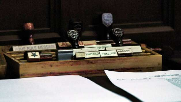 Rubber stamps waiting to be used in the Assembly chamber during budget voting in the Capitol on Wednesday March 28, 2012 in Albany, NY. (Philip Kamrass / Times Union ) Photo: Philip Kamrass / 00017021A