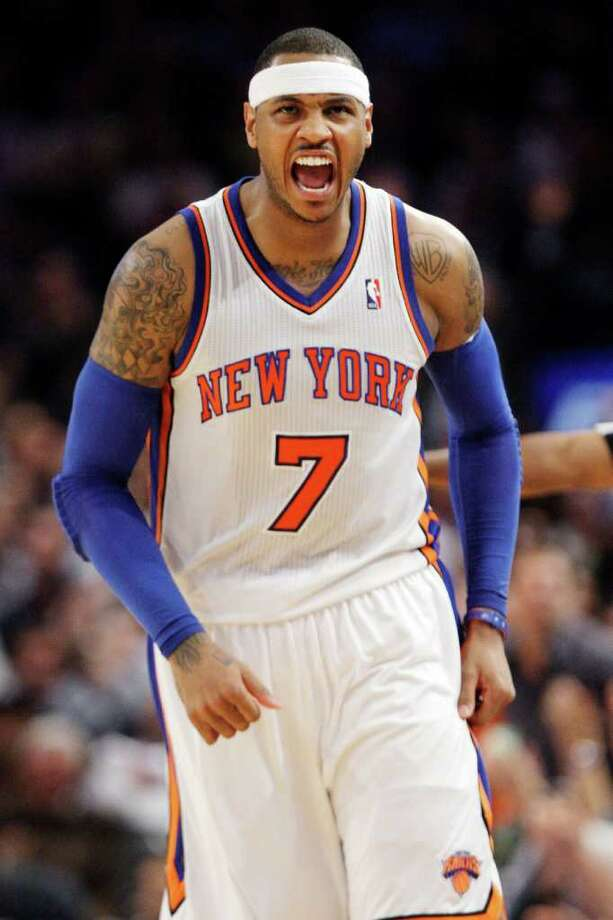 New York Knicks' Carmelo Anthony (7) reacts after scoring during the second half on an NBA basketball game against the Orlando Magic, Wednesday, March 28, 2012, in New York. (AP Photo/Frank Franklin II) Photo: Frank Franklin II