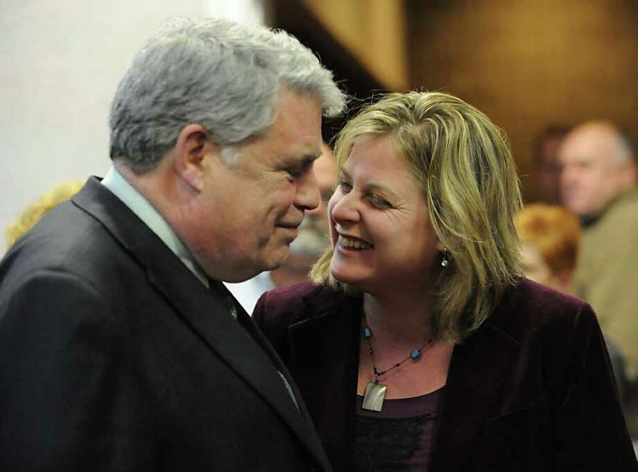 Assemblyman Jack McEneny has a laugh with his daughter Rachel after announcing that he wouldn't be running for re-election at the Albany County Democratic Committee meeting at the Polish Community Center Wednesday March 28, 2012 in Albany, N.Y. (Lori Van Buren / Times Union) Photo: Lori Van Buren