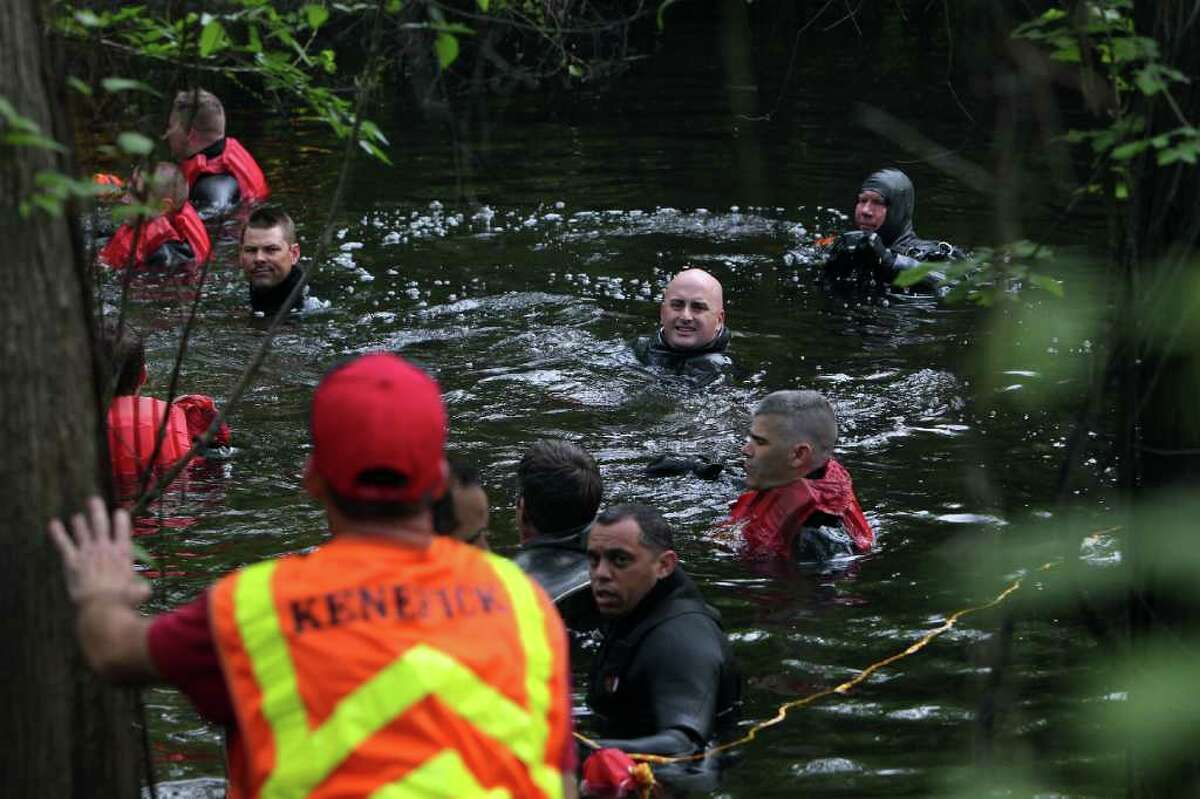 Houston police marine unit divers search for 2-year-old Devin Davis in a creek next to his home in Liberty County east of Cleveland. The little boy went missing Tuesday afternoon while his mother was taking a nap..