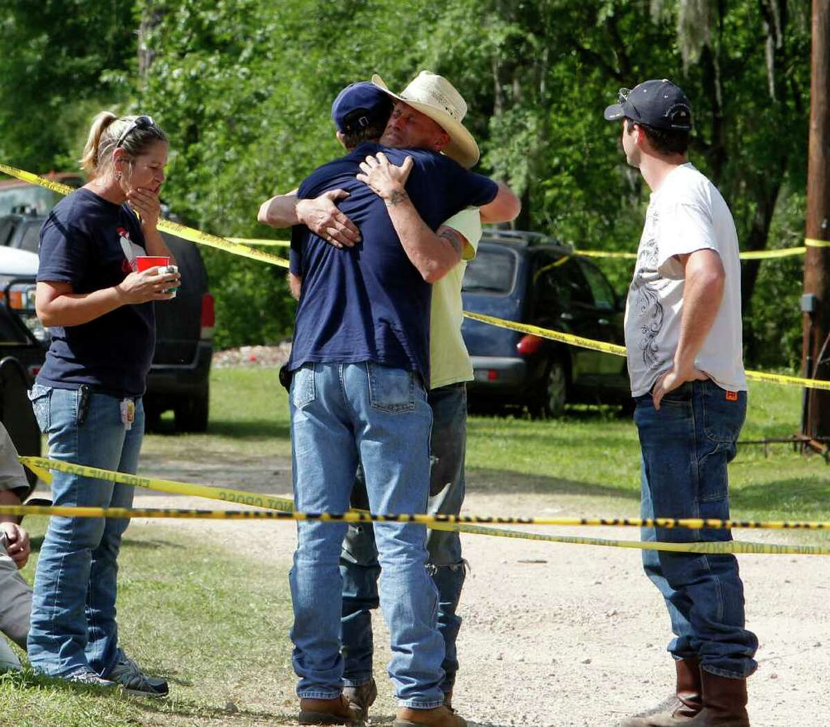 Mike Davis, center right, Devin's father, gets from one of the many volunteers searching the alligator- and snake-infested area for his little boy.