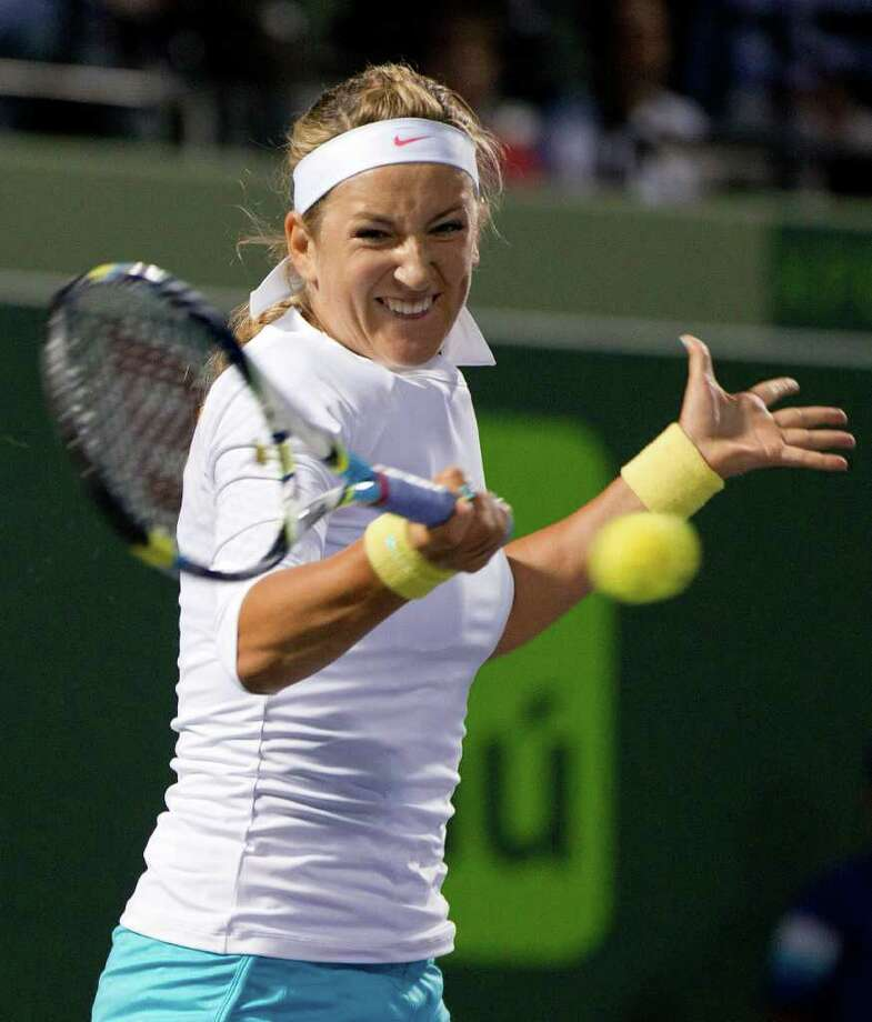 Victoria Azarenka, of Belarus, returns the ball to Marion Bartoli, of France, during the Sony Ericsson Open tennis tournament in Key Biscayne, Fla. Wednesday, March 28, 2012.(AP Photo/J Pat Carter) Photo: J Pat Carter
