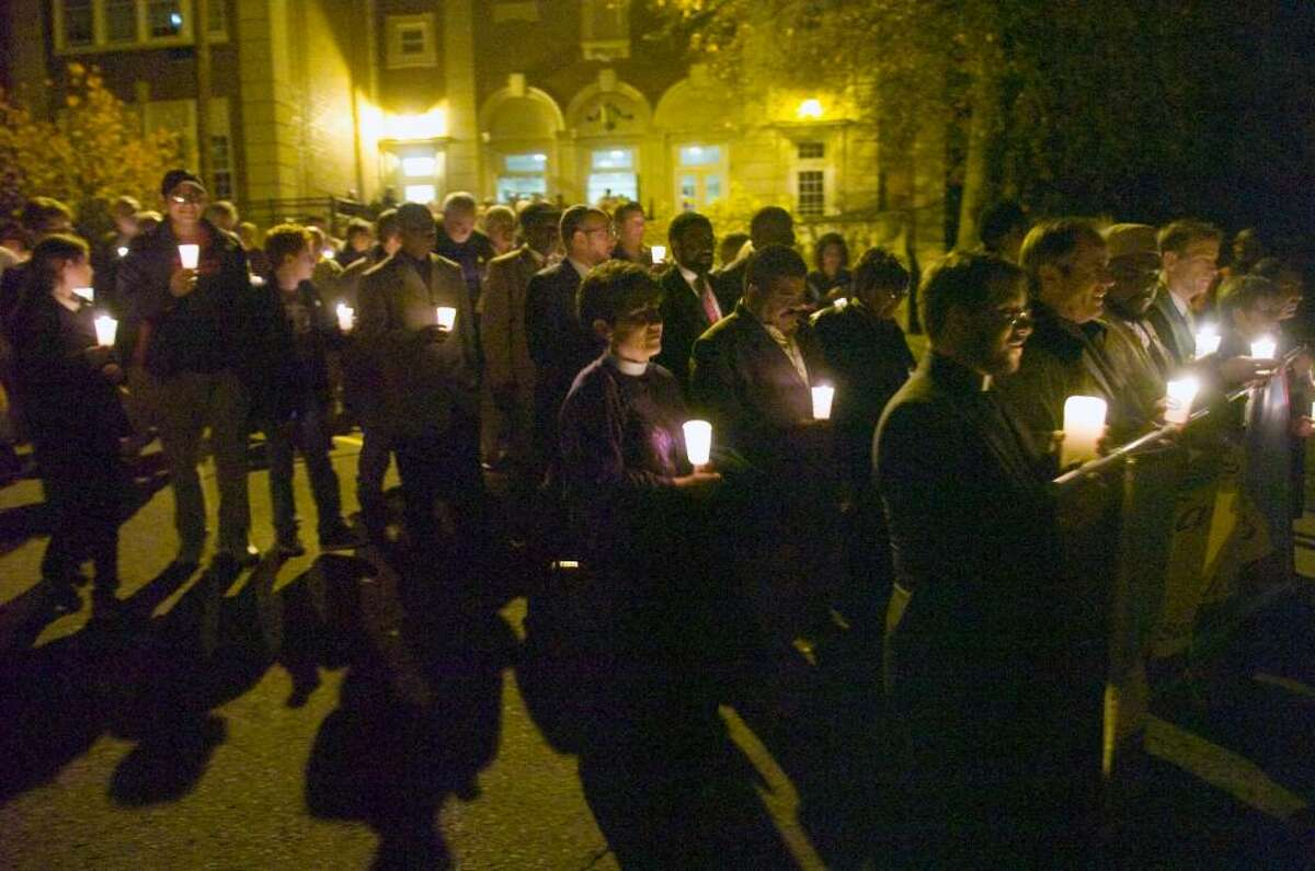 An estimated crowd of 475 files out of Stamford High School to hold a candle light vigil outside of Sen. Joseph Lieberman's Strawberry Hill Ave. apartment building in Stamford, Conn. on Sunday, Nov. 15, 2009 urging to withdraw his opposition to the public option in the health care reform bill. The event was held by the Interfaith Fellowship for Universal Health Care.