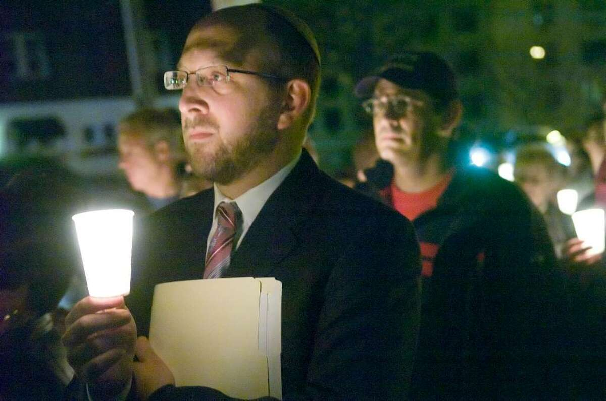 Rabbi Ron Fish, of Congregation Beth El, in Norwlak, stands among hundreds holding a candle light vigil outside of Sen. Joseph Lieberman's Strawberry Hill Ave. apartment building in Stamford, Conn. on Sunday, Nov. 15, 2009 urging to withdraw his opposition to the public option in the health care reform bill. The event was held by the Interfaith Fellowship for Universal Health Care.
