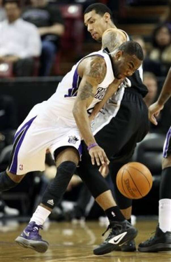 Sacramento Kings guard Marcus Thornton, left, is fouled by San Antonio Spurs guard Danny Green during the first quarter of an NBA basketball game in Sacramento, Calif., Wednesday, March 28, 2012. (AP Photo/Rich Pedroncelli) (AP)