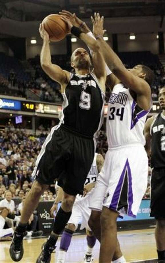 San Antonio Spurs guard Tony Parker, left, goes to the basket against Sacramento Kings forward Jason Thompson during the first quarter of an NBA basketball game in Sacramento, Calif., Wednesday, March 28, 2012. (AP Photo/Rich Pedroncelli) (AP)
