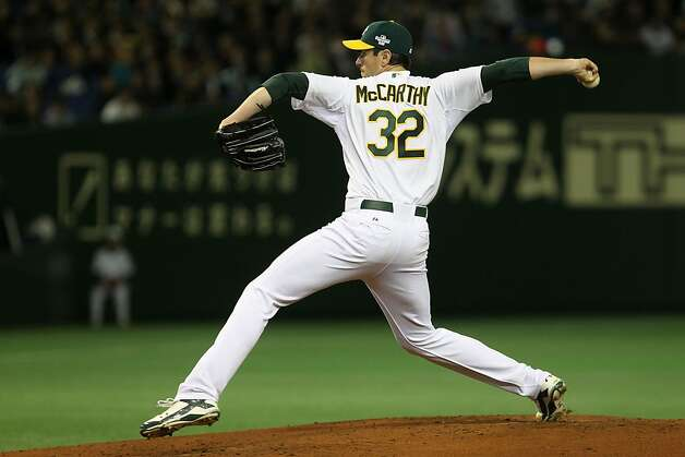 Brandon McCarthy #32 of the Oakland Athletics pitches against the Seattle Mariners during the MLB Opening Series game between the Seattle Mariners and Oakland Athletics at Tokyo Dome on March 28, 2012 in Tokyo, Japan. Photo: Chris McGrath, Getty Images