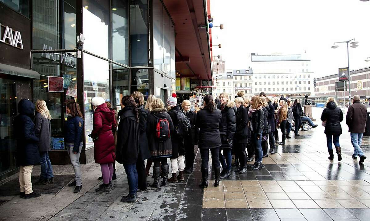 In this photo taken Tuesday March 20, 2012, people queue up to enter the Lunch Beat event at a cultural center in central Stockholm. Lunch Beat events are held monthly in Stockholm to crowds of hundreds where organizers say the party starts at noon and goes on for one hour. There is no alcohol, which means there's a different ambiance compared to nighttime clubbing.