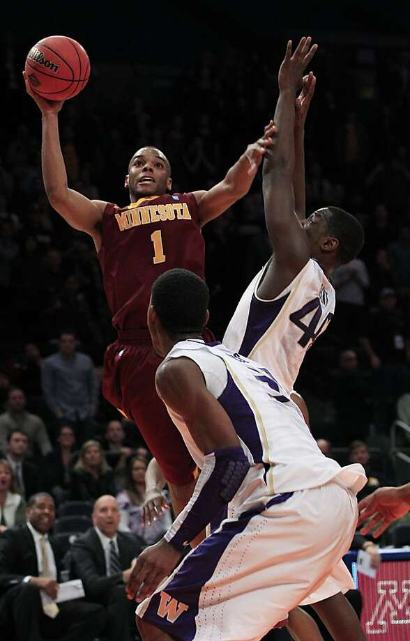 Minnesota's Andre Hollins (1) shoots over Washington's Darnell Gant during the overtime period of an NIT college basketball tournament semifinal game, Tuesday March 27, 2012, in New York. Minnesota won the game 68-67.(AP Photo/Frank Franklin II) Photo: Frank Franklin II, Associated Press