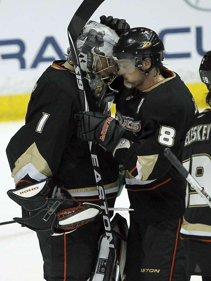 Anaheim Ducks goalie Jonas Hiller (1), of Switzerland celebrates with right wing Teemu Selanne (8) after defeating the San Jose Sharks 3-1 in an NHL hockey game in Anaheim, Calif., Wednesday, March 28, 2012. Photo: Alex Gallardo, Associated Press