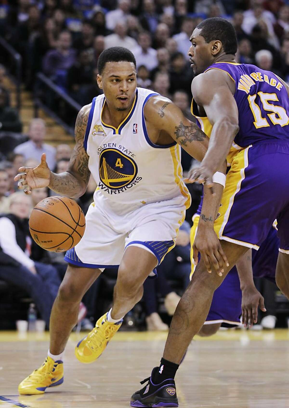 Golden State Warriors shooting guard Brandon Rush (4) loses the ball in front of Los Angeles Lakers small forward Metta World Peace (15) in the fourth quarter of an NBA basketball game in Oakland, Calif., Tuesday, March 27, 2012. The Lakers defeated the Warriors 104-101. (AP Photo/Paul Sakuma)