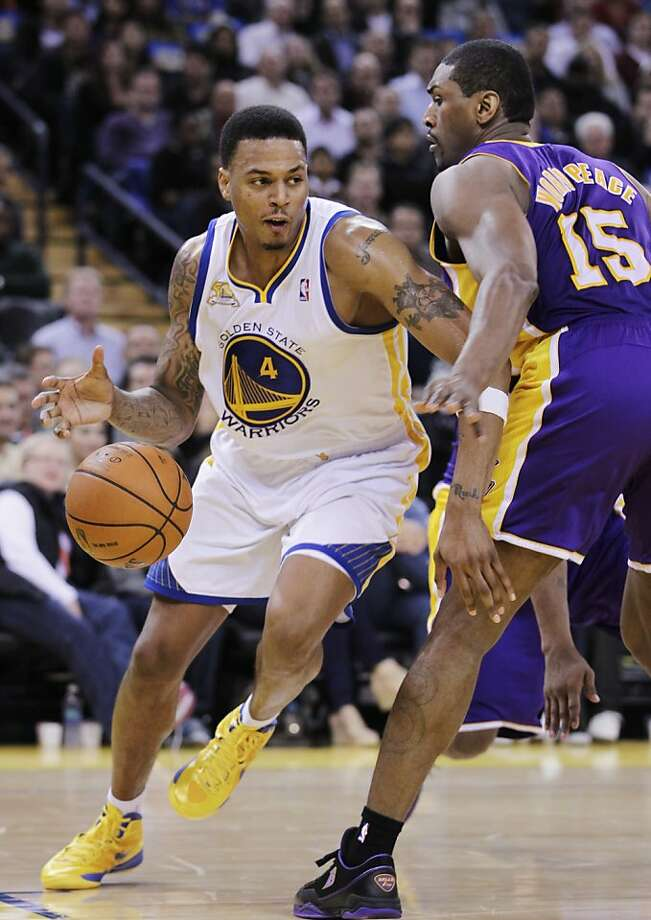 Golden State Warriors shooting guard Brandon Rush (4) loses the ball in front of Los Angeles Lakers small forward Metta World Peace (15) in the fourth quarter of an NBA basketball game in Oakland, Calif., Tuesday, March 27, 2012. The Lakers defeated the Warriors 104-101. (AP Photo/Paul Sakuma) Photo: Paul Sakuma, Associated Press