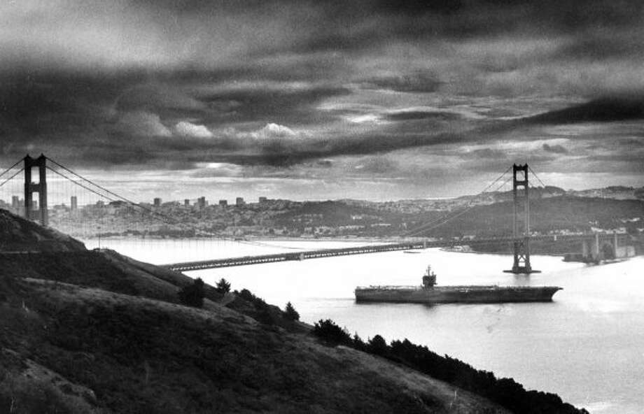 Oct. 31, 1983: The U.S.S. Enterprise aircraft carrier passes underneath the Golden Gate Bridge. The nuclear-powered ship was around during the Cuban missile crisis, and is still in commission.  (John OHara / The Chronicle)