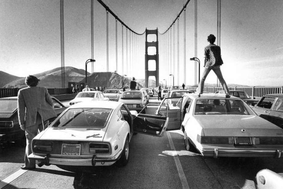 "June 3, 1980: This rush hour traffic jam on the the bridge definitely has a ""Rise of the Planet of the Apes"" vibe. Bonus points to Gary Fong for getting the sweet Nissan 280-ZX in the frame. (Gary Fong / The Chronicle)"